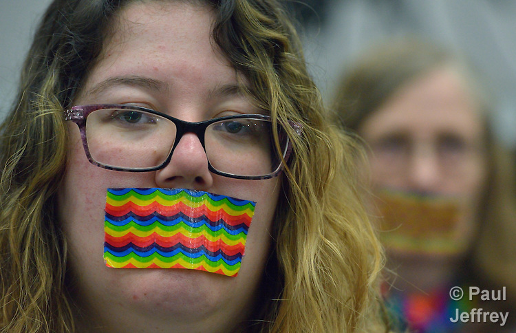 "Demonstrators wear rainbow gags on May 14 to protest what they believe is an attempt to silence LGBTQ voices during the 2016 United Methodist General Conference in Portland, Ore. The silent protest took place at the edge of a plenary session of the conference.<br /> <br /> The United Methodist Church does not authorize the ordination of ""self-avowed practicing homosexuals,"" but activists have for years demonstrated in favor of change at the quadrennial gathering of the world-wide denomination.<br /> <br /> Photo by Paul Jeffrey."