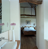 View from the en-suite bathroom into the master bedroom