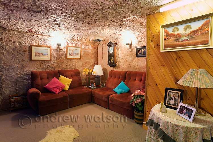 Living room in Faye's underground home.  The dugout home was built by three pioneering women in the 1960s using pick and shovel.  Coober Pedy, South Australia, AUSTRALIA.