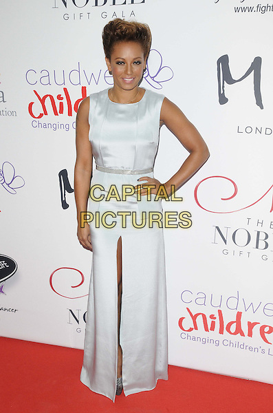 Melanie Brown ( Mel B ) of the Spice Girls .attended the Noble Gift Gala, ME London, The Strand, London, England, UK, 8th December 2012..full length hand on hip white dress silver sleeveless slit split long maxi .CAP/CAN.©Can Nguyen/Capital Pictures.