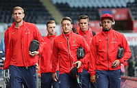 (L-R) Per Mertesacker, Mesut Ozil arriving prior to the Barclays Premier League match between Swansea City and Arsenal at the Liberty Stadium, Swansea on October 31st 2015