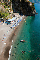 Sunbaking on the beach of Castiglione, on the Amalfi Coast, Italy