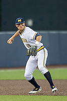 Michigan Wolverines third baseman Jake Bivens (18) prepares to make a throw to first base against the Oakland Golden Grizzlies on May 17, 2016 at Ray Fisher Stadium in Ann Arbor, Michigan. Oakland defeated Michigan 6-5 in 10 innings. (Andrew Woolley/Four Seam Images)