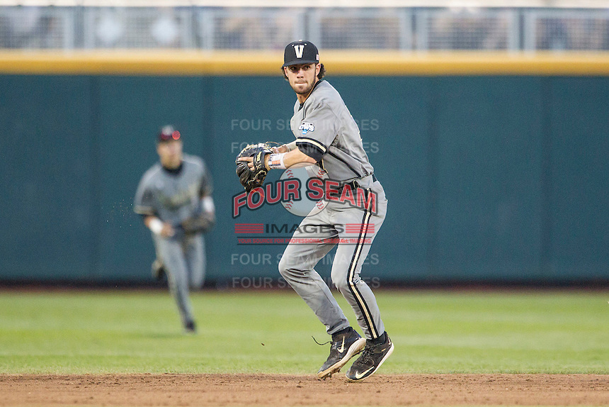 Vanderbilt Commodores shortstop Dansby Swanson (7) prepares to make a throw to first base during the NCAA College baseball World Series against the TCU Horned Frogs on June 16, 2015 at TD Ameritrade Park in Omaha, Nebraska. Vanderbilt defeated TCU 1-0. (Andrew Woolley/Four Seam Images)