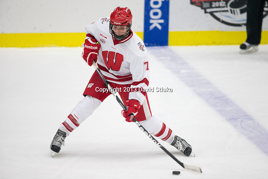 Wisconsin Badgers Kelly Jaminski (7) shoots the puck during an NCAA women's college playoff ice hockey game against the St. Cloud State Huskies Saturday, March 2, 2013, in Madison, Wis. The Badgers won 4-1. (Photo by David Stluka)