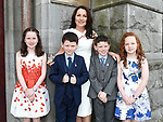 Twins Paraic and Seamus Keenan from St. Mary's school who received First Holy Communion in St. Mary's church with sisters Anna and Eilish and mam Siobhan.  Photo:Colin Bell/pressphotos.ie
