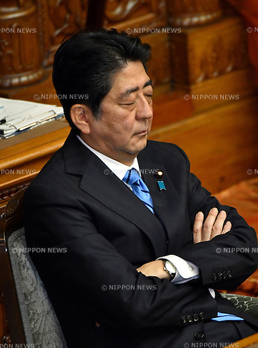 January 24, 2017, Tokyo, Japan - Japan's  Prime Minister Shinzo Abe contemplates as he is asked questions by Renho (single name), leader of the opposition Democratic Party, during a question-and-answer session in the Diet's upper chamber in Tokyo on Tuesday, January 24, 2017. The ordinary session of the Diet started for 150 days on Monday.  (Photo by Natsuki Sakai/AFLO) AYF -mis-