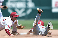 NWA Democrat-Gazette/CHARLIE KAIJO South Carolina infielder Jonah Bride (20) slides to second during the second game of the NCAA super regional baseball, Sunday, June 10, 2018 at Baum Stadium in Fayetteville. Arkansas fell to South Carolina 5-8.