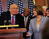 United States Representative John Dingell (Democrat of Michigan), left, U.S. House Majority Whip Jim Clyburn (Democrat of South Carolina), center; and U.S. House Speaker Nancy Pelosi (Democrat of California), right, celebrate the passage of the health care reform bill in the U.S. Capitol in Washington, D.C. early Monday morning, March 22, 2010. Photo Credit: Ron Sachs/CNP/AdMedia