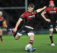 Watford, England. Owen Farrell of Saracens kicks a conversion during the Heineken Cup match between Saracens and Munster Rugby at the Vicarage Road on December 16, 2012 in Watford, England.