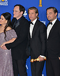 Margaret Qualley, Quentin Tarantino, Brad Pitt,  Leonardo DiCaprio 148 poses in the press room with awards at the 77th Annual Golden Globe Awards at The Beverly Hilton Hotel on January 05, 2020 in Beverly Hills, California.