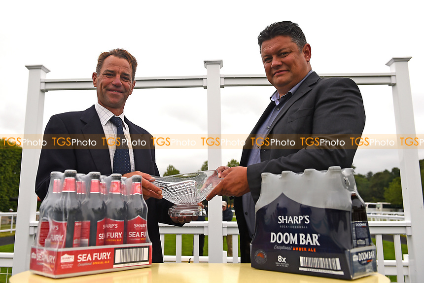 Connections of Examiner receive their trophy for winning The Molson Coors Handicap (Class 2), during Whitsbury Manor Stud Bibury Cup Day Racing at Salisbury Racecourse on 28th June 2017