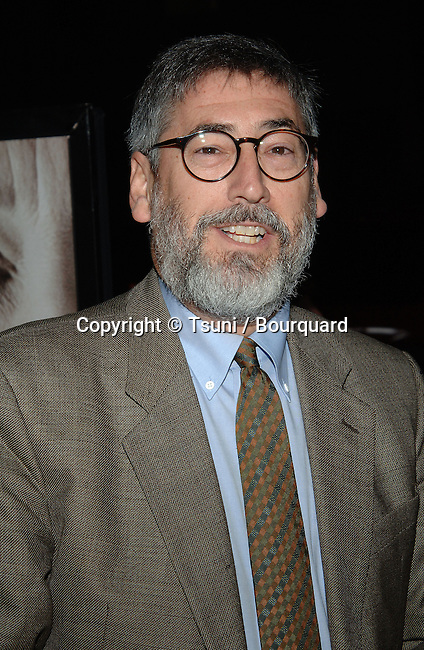 John Landis arriving at THE QUEEN premiere at the Academy Of Motion Pictures &amp; Science  In Los Angeles.<br /> <br /> headshot<br /> smile<br /> eye contact<br /> glass