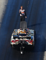 Jun 17, 2016; Bristol, TN, USA; Crew member with NHRA funny car driver Matt Hagan during qualifying for the Thunder Valley Nationals at Bristol Dragway. Mandatory Credit: Mark J. Rebilas-USA TODAY Sports