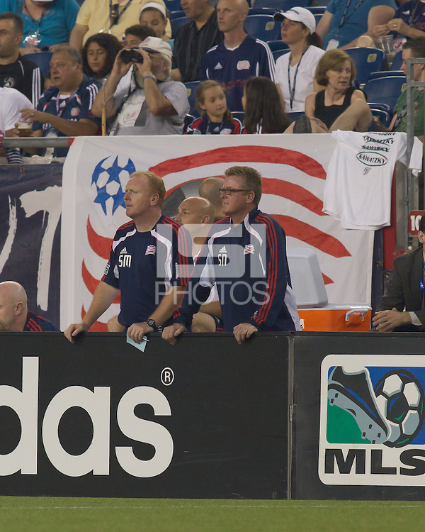 Steve Myles, and Steve Nicol watch play from the bench. The Chicago Fire defeated the New England Revolution, 1-0, at Gillette Stadium on June 27, 2010.
