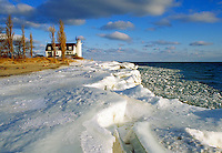 Winter ice and snow at Point Betsie Lighthouse on Lake Michigan near Frankfort. Frankfort Michigan USA Lake Michigan.