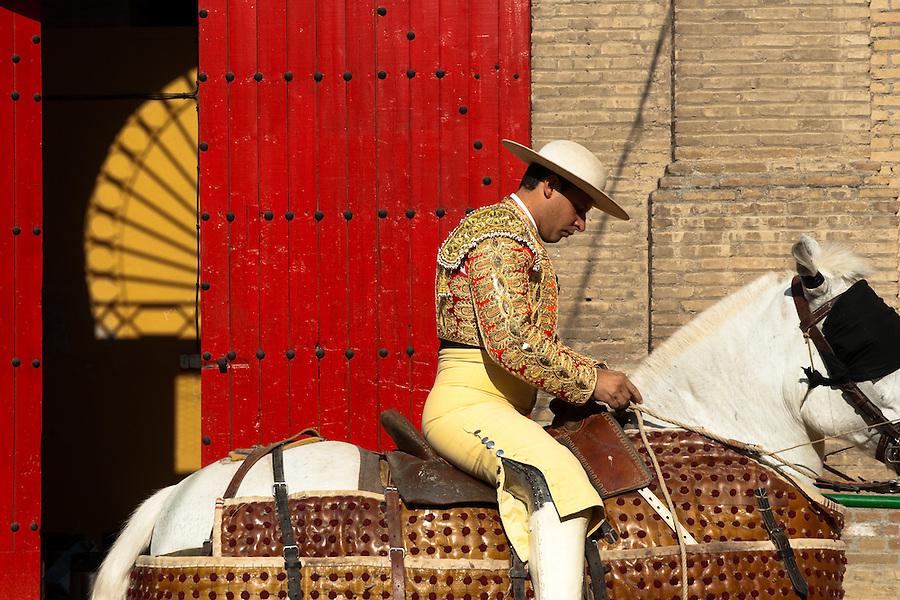 A Spanish bullfighter (picador) prepares his horse in front of the bullring in Granada, Spain, 7 June 2006.