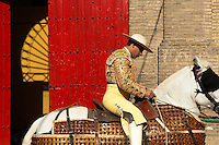 A Spanish bullfighter (picador) prepares his horse in front of the bullring in Granada, Spain, 7 June 2006.