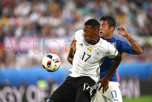 02.07.2016. Bordeaux, France.  Germany's Jerome Boateng shields from Italy's Eder Citadin Martins during the UEFA EURO 2016 quarter final  match between Germany and Italy at the Stade de Bordeaux in Bordeaux, France, 02 July 2016.