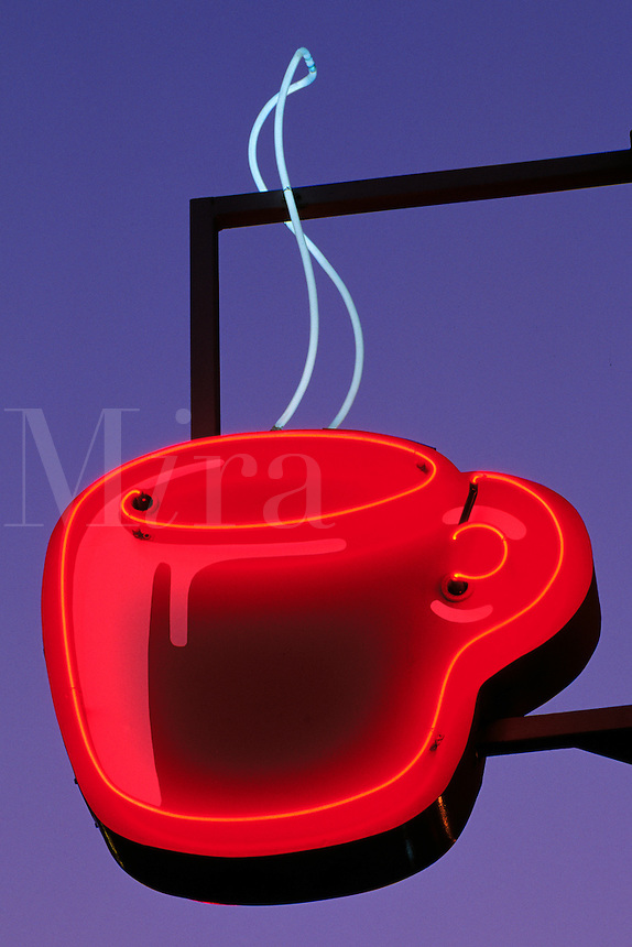 Red Neon Coffee Cup Sign Against Blue Sky; Seattle's Best Coffee, Pike Place Market, Seattle, Washingto