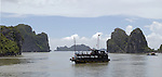 Halong-Vietnam, Ha Long - Viet Nam - 22 July 2005---Typical passenger boat for cruising tourists in the characteristic landscape dominated by limestone rocks and islets at Halong Bay, a UNESCO World Natural Heritage Site---tourism, transport, landscape, nature---Photo: Horst Wagner/eup-images