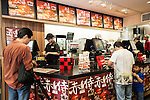 Customers buy the ''AKA SAMURAI CHICKEN'' or ''AKA SAMURAI BEEF'' at Burger King restaurant on Friday July 3, 2015, in Tokyo, Japan. The two new burgers ''AKA SAMURAI CHICKEN'' and ''AKA SAMURAI BEEF'' use red buns and red cheese, colored by tomato powder and spicy red sauce and will be sold at Japanese branches until August. The AKA SAMURAI CHICKEN costs 540 JPY (4.39 USD) and the AKA SAMURAI BEEF costs at 690 JPY (5.61 USD). As a part of the promotion Burger King plans to launch two new black burgers on August 21st. (Photo by Rodrigo Reyes Marin/AFLO)