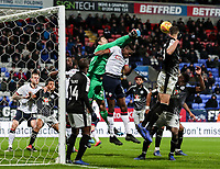 Bolton Wanderers' Sammy Ameobi competing with Reading's goalkeeper Emiliano Martinez  <br /> <br /> Photographer Andrew Kearns/CameraSport<br /> <br /> The EFL Sky Bet Championship - Bolton Wanderers v Reading - Tuesday 29th January 2019 - University of Bolton Stadium - Bolton<br /> <br /> World Copyright © 2019 CameraSport. All rights reserved. 43 Linden Ave. Countesthorpe. Leicester. England. LE8 5PG - Tel: +44 (0) 116 277 4147 - admin@camerasport.com - www.camerasport.com