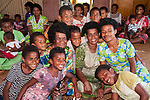 Viti Levu, Fiji; villagers pose for a photo during a cultural tour