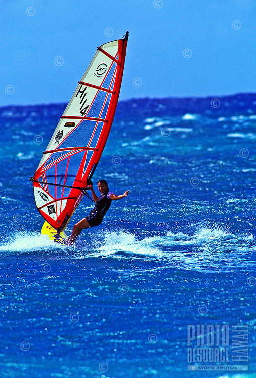 Woman windsurfing Kahana beachpark, Maui