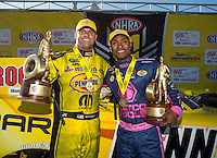Oct 16, 2016; Ennis, TX, USA; NHRA funny car driver Matt Hagan (left) celebrates with top fuel driver Antron Brown after winning the Fall Nationals at Texas Motorplex. Mandatory Credit: Mark J. Rebilas-USA TODAY Sports