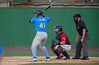 Myrtle Beach Pelicans Wladimir Galindo (41) at bat in front of catcher Jakson Reetz and umpire Josh Gilreath during a Carolina League game against the Potomac Nationals on August 14, 2019 at Northwest Federal Field at Pfitzner Stadium in Woodbridge, Virginia.  Potomac defeated Myrtle Beach 7-0.  (Mike Janes/Four Seam Images)