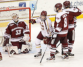 Paul Carey (BC - 22) celebrates Tommy Cross's goal which made it 2-0 BC late in the second period. - The Boston College Eagles defeated the visiting University of Massachusetts-Amherst Minutemen 2-1 in the opening game of their 2012 Hockey East quarterfinal matchup on Friday, March 9, 2012, at Kelley Rink at Conte Forum in Chestnut Hill, Massachusetts.