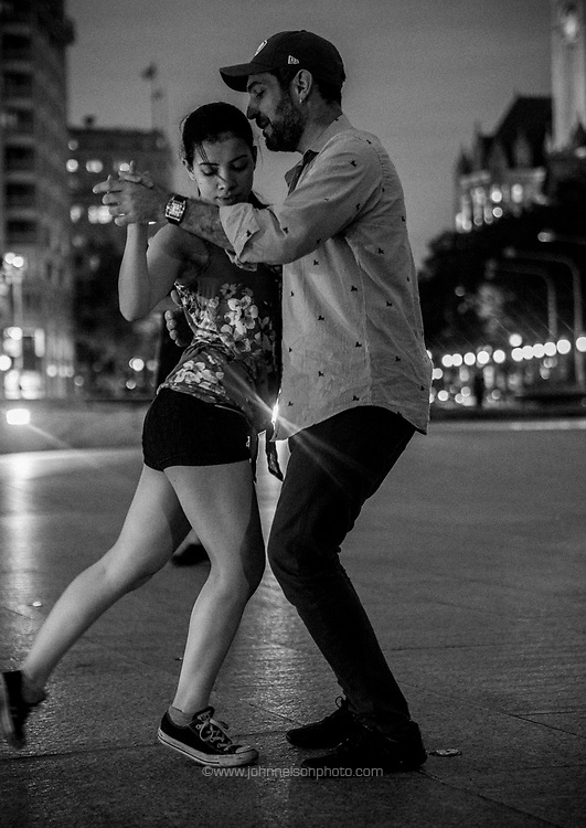 Couples dance the Tango on Freedom Plaza in Washington, DC