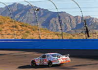 Apr 10, 2008; Avondale, AZ, USA; NASCAR Sprint Cup Series driver Kyle Busch during qualifying for the Subway Fresh Fit 500 at Phoenix International Raceway. Mandatory Credit: Mark J. Rebilas-