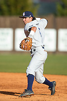 Florida Atlantic Owls second baseman Stephen Kerr (6) makes a throw to first base against the Charlotte 49ers at Hayes Stadium on March 14, 2015 in Charlotte, North Carolina.  The Owls defeated the 49ers 8-3 in game one of a double header.  (Brian Westerholt/Four Seam Images)