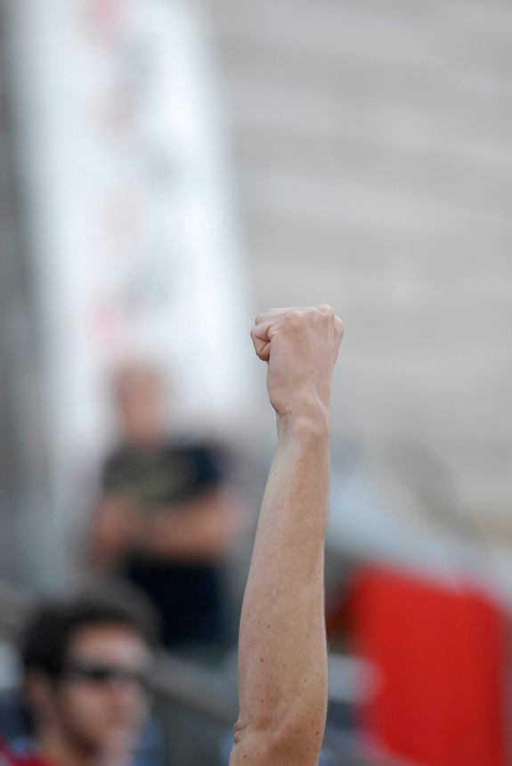 24 Aug 08: An individual in a crowd pumps his fist in the air during a series of speeches given on the steps of the Colorado state capitol building. On the day before the Democratic National Convention is scheduled to begin about 1,500 people participated in the ReCreate 68 rally, which included a march from the Colorado state capitol building to the Pepsi Center.