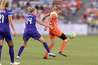 Houston, TX - Friday May 20, 2016: Morgan Brian (6) of the Houston Dash gains control of a loose ball in front of Becky Edwards (14) of the Orlando Pride. The Orlando Pride defeated the Houston Dash 1-0 during a regular season National Women's Soccer League (NWSL) match at BBVA Compass Stadium.