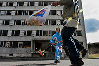 Boys, having their bag full of Easter eggs, happily dance in front of a devastated apartment block in the Gipsy ghetto of Chanov, Most, Czech Republic, 26 March 2008.