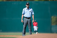 Umpire Emil Jimenez during the South Atlantic League game between the Asheville Tourists and the Kannapolis Intimidators at Kannapolis Intimidators Stadium on May 7, 2017 in Kannapolis, North Carolina.  The Tourists defeated the Intimidators 4-1.  (Brian Westerholt/Four Seam Images)