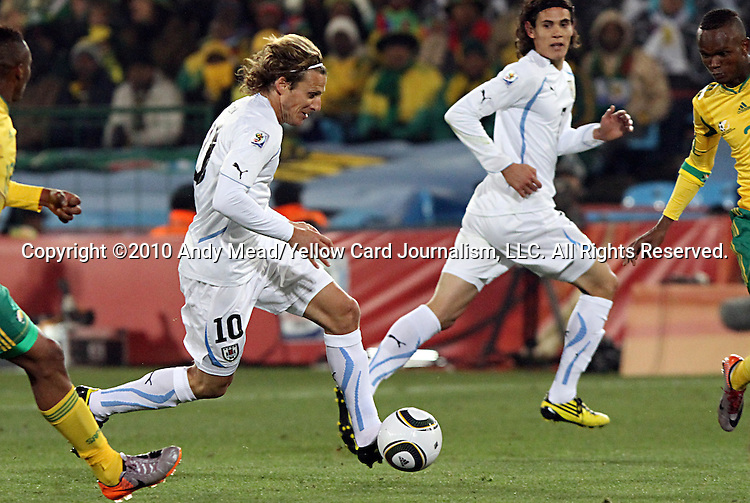 16 JUN 2010:  Diego Forlan (URU)(10) weaves his way towards the goal.  The South Africa National Team were defeated bythe Uruguay National Team 0-3 at Loftus Versfeld Stadium in Tshwane/Pretoria, South Africa in a 2010 FIFA World Cup Group A match.