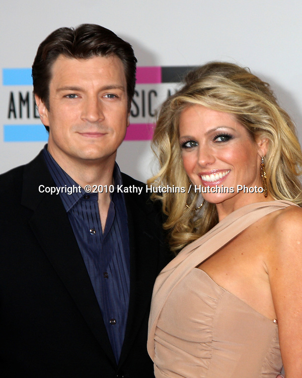 LOS ANGELES - NOV 21:  Nathan Fillion; Kate Luyben  arrives at the 2010 American Music Awards at Nokia Theater on November 21, 2010 in Los Angeles, CA