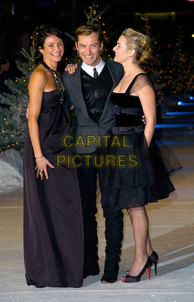 "CAMERON DIAZ, JUDE LAW & KATE WINSLET.At the UK Film Premiere of ""The Holiday"", Odeon Leicester Square, London, UK..December 5th 2006.full length black puffy puffball skirt dress open toe Christian Louboutin shoes red soles halterneck grey gray suit jacket arms around waist profile.CAP/CAN.©Can Nguyen/Capital Pictures"