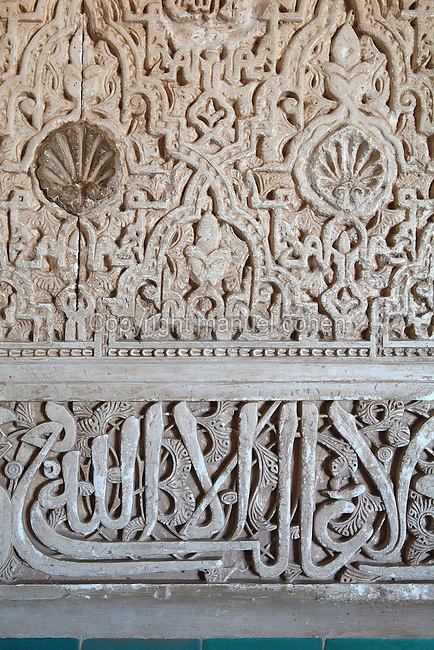 Decorative stucco carving and koranic inscriptions on the walls of the Patio of the Gilded Room, between the Mexuar and the Gilded Room or Cuarto Dorado, built under Mohammed V in the 14th century, in the Comares Palace, Alhambra Palace, Granada, Andalusia, Southern Spain. The Alhambra was begun in the 11th century as a castle, and in the 13th and 14th centuries served as the royal palace of the Nasrid sultans. The huge complex contains the Alcazaba, Nasrid palaces, gardens and Generalife. Picture by Manuel Cohen