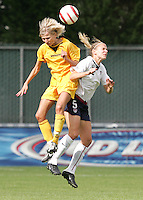 10 July 2005:  Lindsay Tarpley of USA battles for the ball against Ukraine defender during the second half of the game at Merlo Field at University of Portland in Portland, Oregon.    USA defeated Ukraine, 7-0.   Credit: Michael Pimentel / ISI