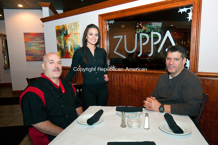 WATERBURY,  CT-010615JS03-THIS IS FOR AN IN HOUSE AD FOR THE VALENTINES CONTEST FOR ADVERTISING. John Rush, Executive Chef at Zuppa Italian Pub in Wolcott, left, with hostess Karli Griffin and owner Bryan Elisa.<br />  Jim Shannon Republican-American