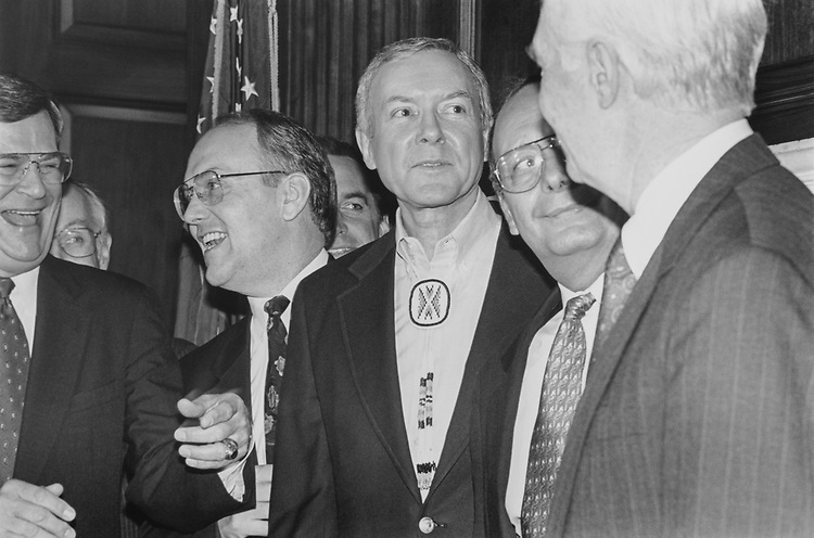 Sen. Trent Lott, R-Miss., Sen. Larry Craig, R-Idaho, Sen. Al D'Amato, R-N.Y., and Sen. Thad Cochran, R-Miss., giggle at Sen. Orrin Hatch's, R-Utah, bolo tie (which imitates Sen. Campbell's tie), on March 6, 1995. (Photo by Laura Patterson/CQ Roll Call via Getty Images)