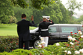 United States President Barack Obama waves to President Hamid Karzai of Afghanistan upon his departure on the South Lawn Drive of the White House, Wednesday, May 12, 2010..Mandatory Credit: Pete Souza - White House via CNP
