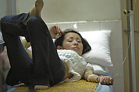 Ah Li, a 21 year-old female drug addict stays in a clinic in Shenzhen, China, after collapsing from serious drug addiction.  Ah Li moved to Shenzhen from northern China when just sixteen years old after the break-up of her family. She was tricked into prostitution and initially forced to take drugs until she became addicted and dependent on her gang bosses.
