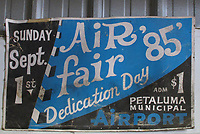 Petaluma Municipal Airport Airfaire 1985 dedication day poster hanging in a Petaluma airport hangar , Petaluma, Sonoma County, California
