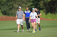 Alan Lowry, Kate Whyte and friends walking down the 10th fairway during the preview for the DP World Tour Championship at the Earth course,  Jumeirah Golf Estates in Dubai, UAE,  18/11/2015.<br /> Picture: Golffile | Thos Caffrey<br /> <br /> All photo usage must carry mandatory copyright credit (© Golffile | Thos Caffrey)